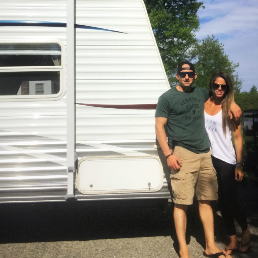Crystal and Jesse taking a photo near an RV