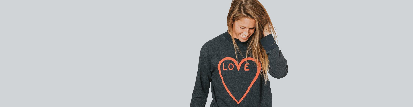 Crystal Seaver in a gray sweater that says love inside of a heart