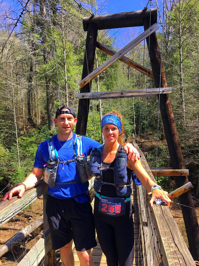 Crystal and Jess on a bridge while running the Georgia Death Race
